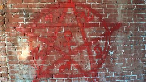 Pentagram, symbol of Satan on a brick wall. 4K Footage