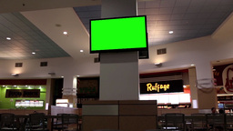 Green billboard for your ad at tv inside food court at Coquitlam Center shopping Footage