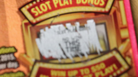 Close up lottery ticket for slot play bonus area Stock Video Footage