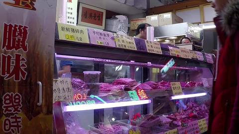 Woman buying meat at Chinese supermarket Live Action