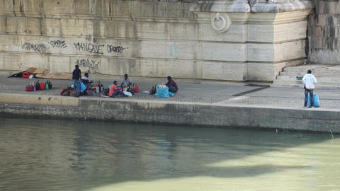 Homeless Immigrants Living Under a Bridge in Rome Live Action