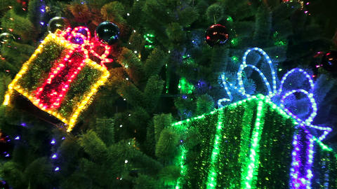 Decorated Christmas Tree With Flashing Gift Boxes and Glowing Lights Footage