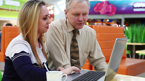 Young Woman And Man Sitting On The Couch In The Shopping Center And Work With A  stock footage
