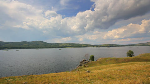 timelapse landscape with lake between hills Footage