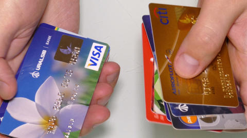 Man's Hands Are Sorting Credit Cards stock footage
