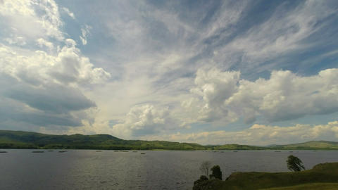 Beautiful Timelapse Landscape With Lake Between Hills stock footage