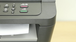 Front view of printer printing one page Footage