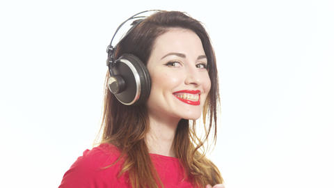 Gorgeous Girl In Red Swaying Along With The Music In Big Headphones Noticing stock footage
