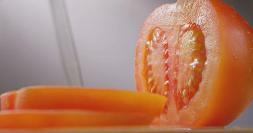 Knife Cutting Tomato stock footage