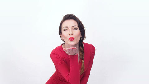 lady in red sending an air kiss Footage