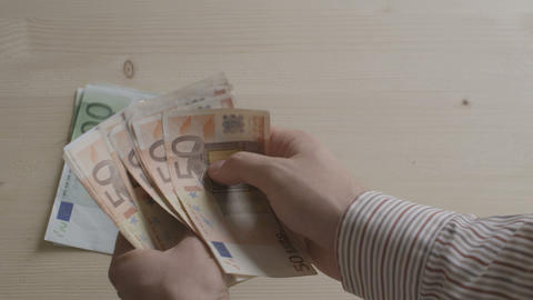 Person Counting Euro Bills stock footage