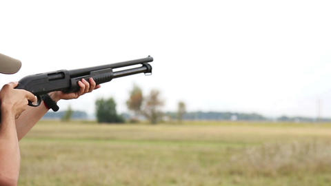 Man with pump rifle shooting outdoor Live Action