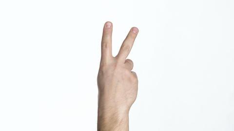 hand showing palm back V sign Footage