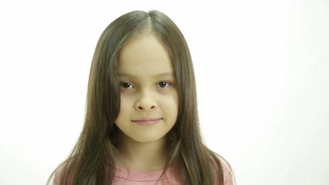 Young girl looking up and then glancing sideways Footage