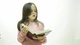 Young Girl Reading A Book stock footage