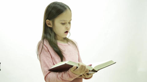 Young girl reading a book Live Action