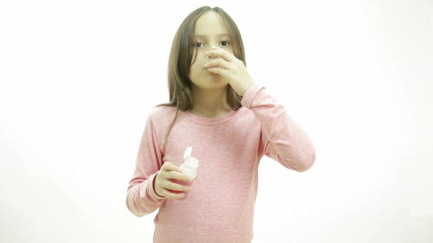 Young girl taking medicine by herself Footage