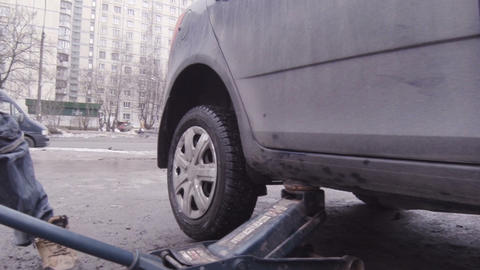 Replacement Of The Wheels On The Vehicle stock footage