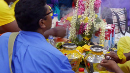 4K Ultra HD video of devotees preparing milk pots and garlands on Thaipusam day Footage