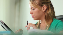 Young Woman Female Student Studying With Tablet PC stock footage