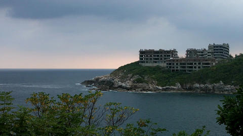 Hotel Under Construction on the shore of Pacific Ocean Stock Video Footage