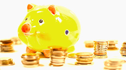 Pig Money Box and Coins 01 DOLLY left Stock Video Footage