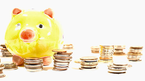 Pig Money Box and Coins 04 DOLLY Stock Video Footage