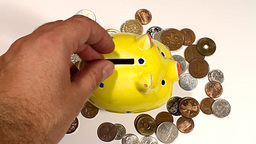Putting Money into Pig Money Box and Coins 01 Stock Video Footage