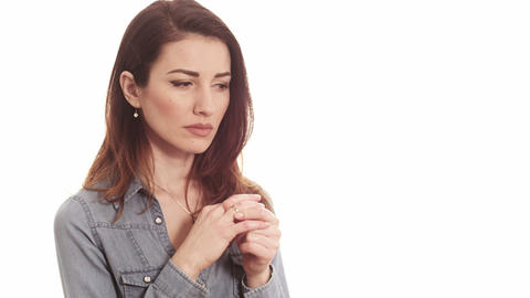 woman touching ring thinking about marriage problems Footage