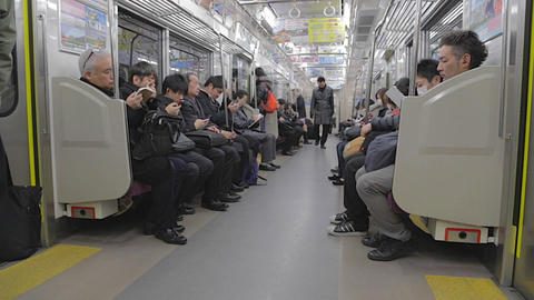 Japanese Businessmen - Tokyo Metro Train stock footage