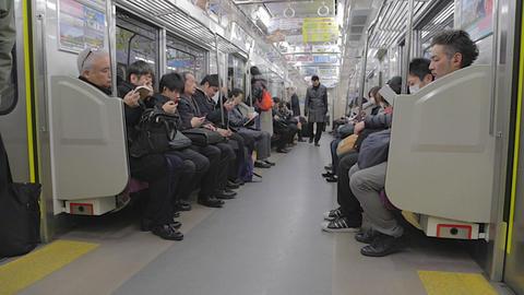 Japanese businessmen - Tokyo metro train Footage