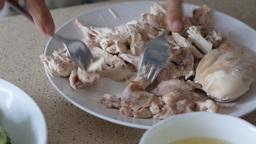 4k UHD Time Lapse On Shredding A Plate Of Boiled Chicken Meat With Two Forks stock footage