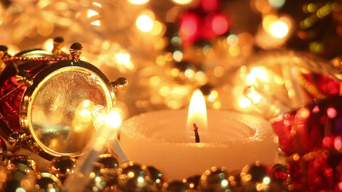 candle and holiday lights close-up seamless loop Footage