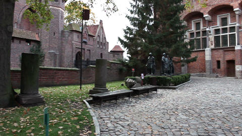 Pan of the medieval castle and statues of Teutonic Grand Masters Footage