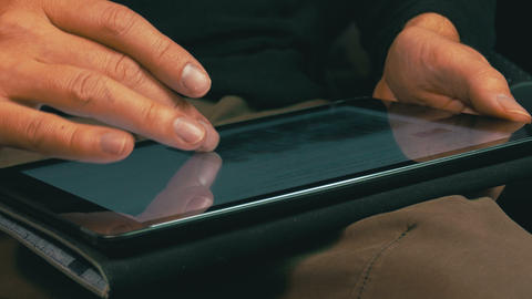 Male Hands Scrolling on a Tablet Computer Footage