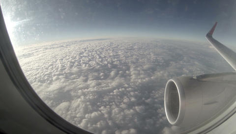 2.7K. Airplane wing out of window on blue sky background, Full HD. 2704x1524 (ti Footage
