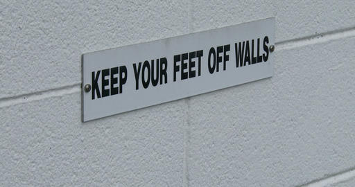 Keep your feet off walls sign Footage