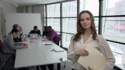 A Caucasian Woman Stands Infront of Professionals in a Meeting (4 of 5) Live Action