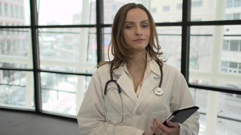 A Caucasian Female Medical Professional Walks Up to the Camera (5 of 9) Footage
