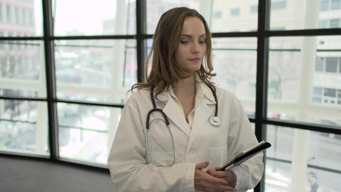 A Caucasian Female Medical Professional Walks Up to the Camera (3 of 9) Footage
