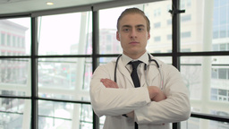A Caucasian Male Medical Professional Walks Up to the Camera (5 of 10) Footage