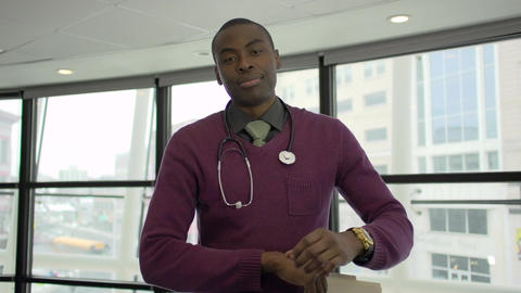 A Black Male Medical Professional Walks Up to the Camera (2 of 5) Footage
