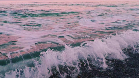 Pink Sea Surf just after Sunset. Slow Motion Footage