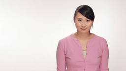 Young Asian Woman Angry Face Portrait In Studio White Background stock footage