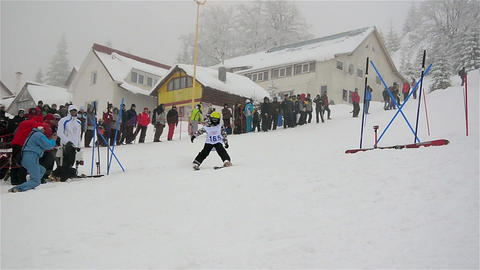 Kids skiing in competition 2 Footage