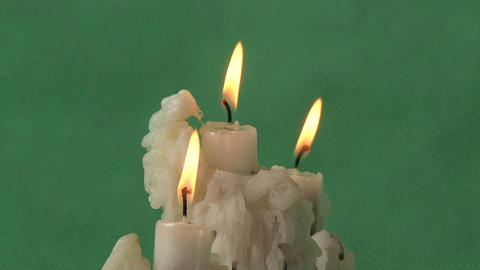 candles on a green background Footage
