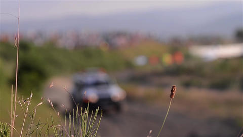 SUV vehicle with flashing lights going along off-road trail - rally 05 Live Action