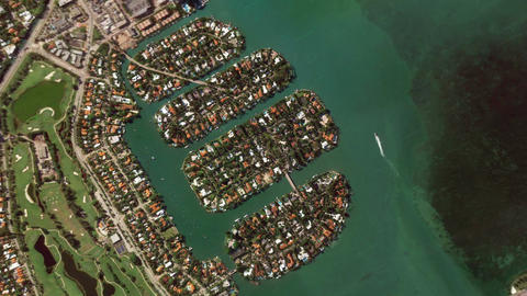 Zoom in from a satellite down to a city on Earth Footage