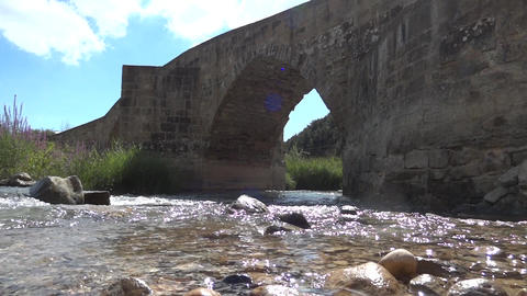 Ancient bridge over a river 02 Footage