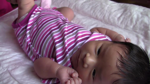 Mother Wipe With A Soft Cloth Newborn Skin 01 stock footage